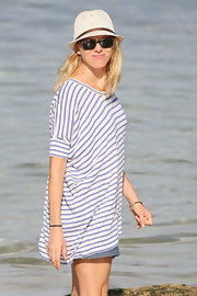 Naomi Watts splashed around in the sea wearing a pair of classic Ray-Ban wayfarers.