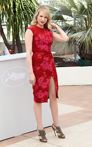 Lucy Punch wore fringed gray sandals with her red dress for the 'You Will Meet a Tall Dark Stranger' photocall.