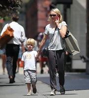 Naomi Watts kept her look super casual with a gray-and-white striped tee.