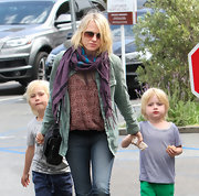 Naomi Watts chose a purple scarf with black and blue stripes while out with her sons in California.