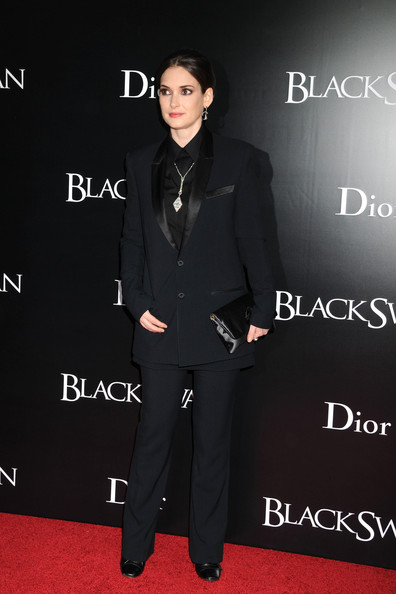 Winona Ryder dons a more masculine style on the red carpet. Here she wears a boxy tuxedo jacket with slim pants and a leather clutch.