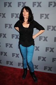 Katey Sagal wore turquoise skinnies with her black top and boots for a bright pop of color.