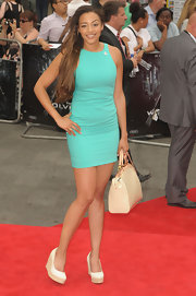 Amai kept her red carpet look simple and chic with a turquoise shift dress.