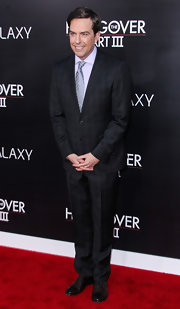 Ed Helms chose a charcoal gray checked suit for his look at the red carpet premiere of 'The Hangover III.'