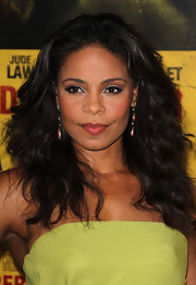 Sanaa Lathan's eyes sparkled at the 'Contagion' premiere. Her trick? Pearly shades of shadow swept across the lower lids. A product like Maybelline Experwear Eyeshadow, in shades like Linen or Golden Halo, works beautifully.