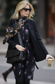 Claudia dons yet another fantastic floral print scarf while out in London. We love her mixing prints with her floral print frock!