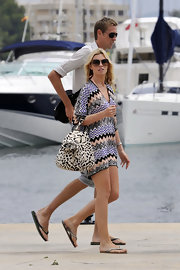 Abbey Clancy sported clashing prints with this dress and tote combo while strolling in Ibiza.