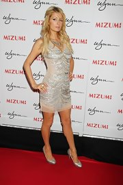 Paris Hilton sparkled on the red carpet at the opening of Mizumi at the Wynn in Las Vegas wearing a silver sequin and beaded mesh overlay dress that was sexy and risque without showing too much skin.