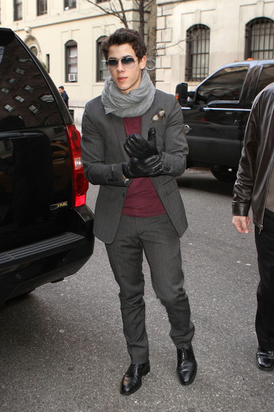 Nick Jonas looked dapper in a gray suit, dressed down by a simple burgundy T-shirt.