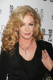 Shannon Tweed added loads of volume to her hair with thick curls.