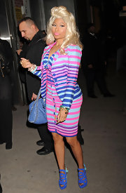 Nicki Minaj brightened up a classic ladylike style in a striped pastel blazer and matching button front dress.