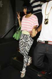 Nicki Minaj gave her street wear a fun twist with a pair of white polka dotted wedge ankle wrap sandals.