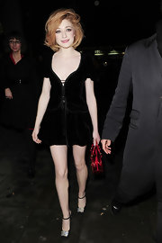 Nicola looked darling in sweet black ankle strap heels. She gave her look sparkle with the rhinestone-embellished heels.