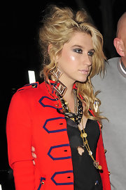 Kesha sported her usual outrageous look with a messy waved updo.