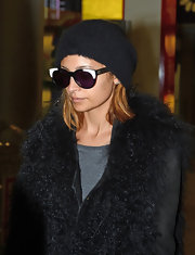 Nicole Richie beat the Parisian chill with a simple black beanie.