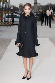Nicole Richie looked feminine and flirty in a black wool coat with ruffles at the Valentino runway show.