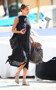 Nicole's sheer, black cover up was a light and airy touch to her vacation look.