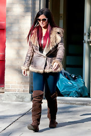 Jenni Farley bundled up in a suede jacket trimmed in fur.