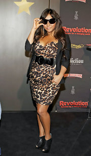 Nicole Polizzi donned  studded black patent cutout booties to the Vision Expo.