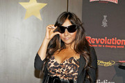 Nicole Polizzi Roars in a Leopard Print Dress