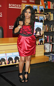 Snookie got a boost from black platform heels with chunky ankle cuffs.
