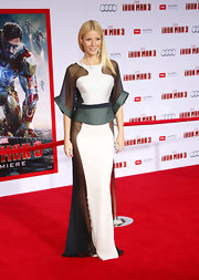 Gwyneth Paltrow chose a cool, contemporary look at the 'Iron Man 3' red carpet with this white dress, featuring sheer paneling, a peplum waist and wide sleeves.