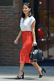 Olivia Munn paired a red print skirt with a white blouse for a casual yet classy finish while out and about in New York City.