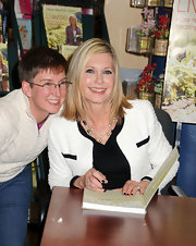 Olivia Newton-John styled her look with a layered pearl necklace at the book signing of 'Livwise.'