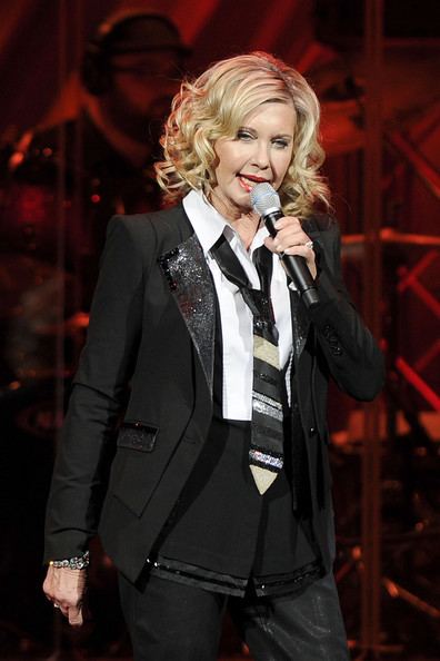 Olivia Newton-John wore a striped necktie at a show in London.