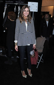 Olivia Palermo looked ladylike at Tibi in a nautical striped jacket with a slight peplum waist.