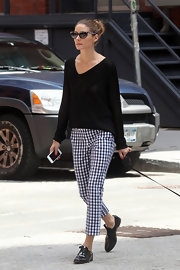 Olivia added some classic spice to her look with these gingham pants.