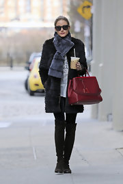 Olivia Palermo rocked the fur on fur look with this gray fur scarf paired over a black fur coat.
