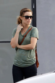 Olivia Wilde dressed down in a relaxed sage green T-shirt and jeans.