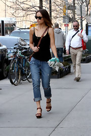 Olivia Wilde enjoyed a warm spring day in NYC with this shoulder-bearing black cami.
