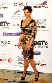 Halle Berry took a walk on the wild side in this sexy leopard print and lace dress for the Jenesse Silver Rose Awards.