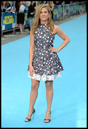 Jennifer Aniston's pumps topped off her feminine look at the 'We're the Millers' premiere  in London.
