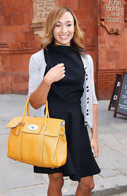 Jessica Ennis went for a classy look with an LBD and a yellow leather tote during Fashion Week.