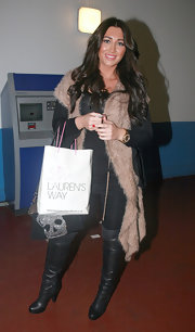 Lauren Goodger snuggled up at the salon to a fuzzy tan vest.