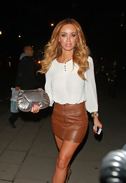 Lauren Pope balanced a skin tight mini skirt with a blousy white top.
