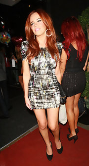 Maria Fowler went for a modern-chic look with this print mini dress during a party in London.
