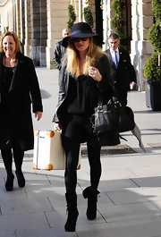 Kate Moss was spotted leaving the Ritz Hotel carrying a black leather tote.