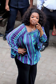 Oprah Winfrey was a colorful sight on the streets of Mumbai in a print peasant blouse.