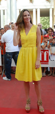 Hilary was a ray of sunshine in a yellow day dress with a pleated bodice for the Giffoni Film Festival. The actress completed her summertime style with a pair of wood wedges.