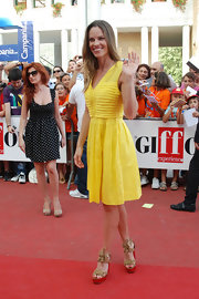 Hilary Swank was a ray of sunshine at the Giffoni Film Festival in a summery yellow frock paired with a pair of red Tarlen wedges with braided rope accents.