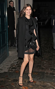 Laetitia Casta topped off her look with black strappy sandals.