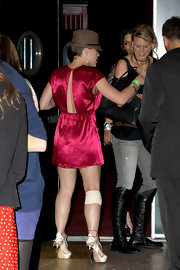 Pink partied with friends in a satin mini dress with a classic fedora hat.