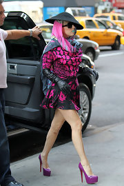 Lady Gaga looked glam in a pair of elbow length leather gloves while out in NYC.