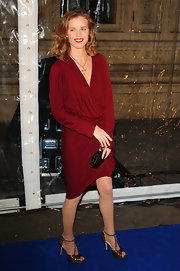 Eva Herzigova wore a pair of nude patterned fishnets with her wine Lanvin dress.