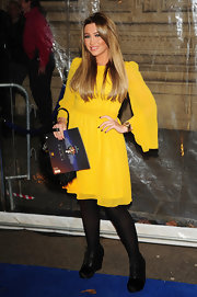 Lauren Goodger wore a bright yellow chiffon dress with winged sleeves for the 'Totem' performance in London.