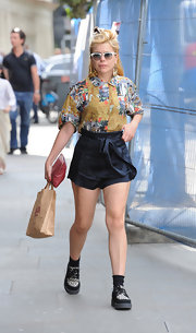 Paloma's high-waisted shorts topped off her unique street style.
